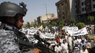 Ein irakischer Polizist bei einer Pro-Maliki-Demonstration vergangene Woche in Bagdad