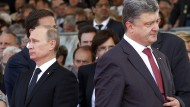 Haben sich eigentlich wenig zu sagen: Die Präsidenten der Ukraine und Russlands Petro Poroschenko und Wladimir Putin