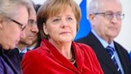 Vertraut: Schavan und Merkel.