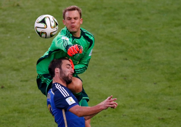 Argentina's Gonzalo Higuain collides with Germany's goalkeeper Manuel Neuer during their 2014 World Cup final at the Maracana stadium in Rio de Janeiro